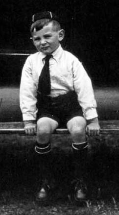 Boy, sitting on running board
