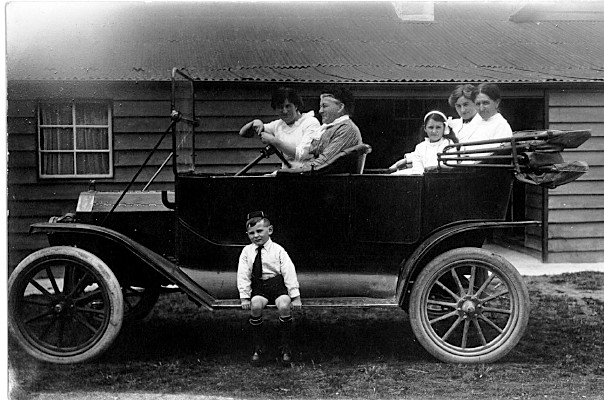 Group of random folks in old car