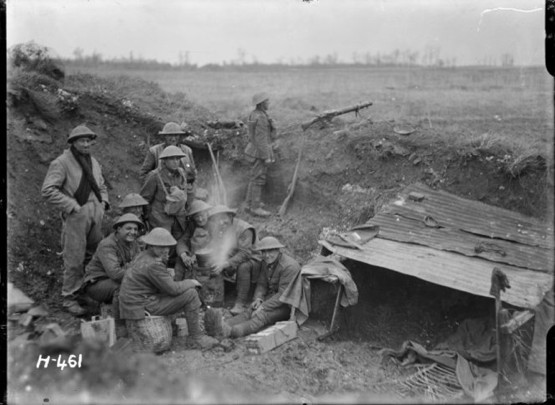 New Zealand soldiers around a billy in a strong post, near Mailly-Maillet, France, during World War I.