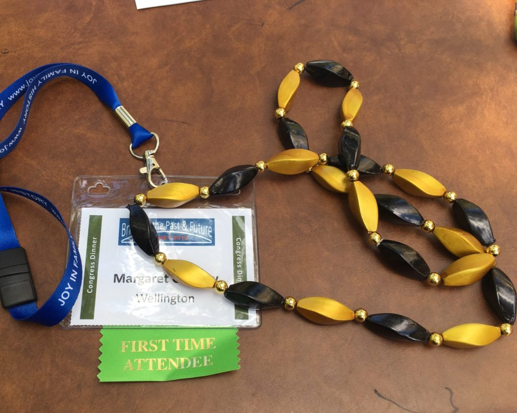 Pre-registration name tag, first time attendee ribbon, and geneablogger beads